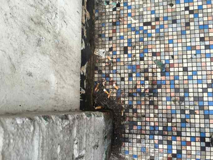 Soho pavement fag-festooned