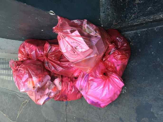 Soho pavement garbage-piled