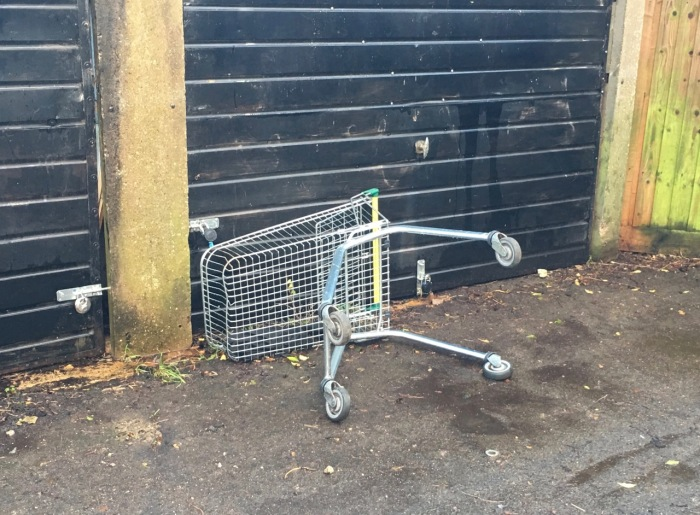 shopping trolley by garage