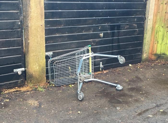 shopping trolley by garage